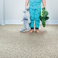 Girl standing with toys on Carpet | Flooring 101