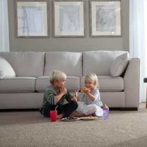 Kids enjoying food sitting on Carpet | Flooring 101