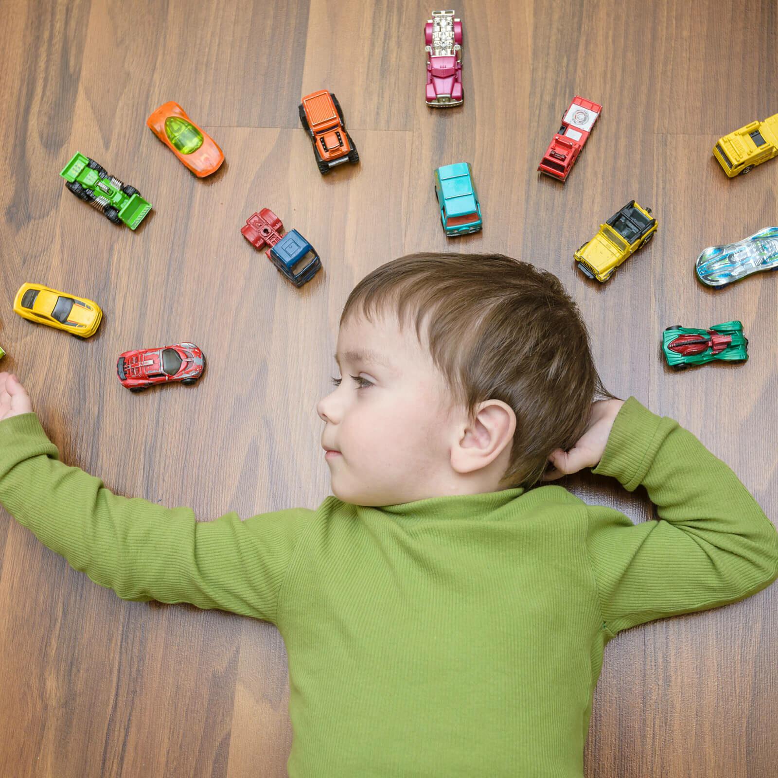 Kid with toy cars on vinyl floor | Flooring 101